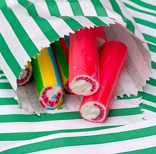 Sticks of rock inside paper bag